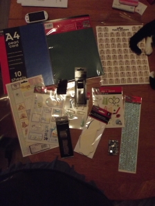This really is a crafter's starter kit. I've not done craft since before university stole all my time, so I thought I should rebuild my collection, and a grab bag with 20% off seemed like a good place to start. It's got a couple of sets of card, and a whole lot of stickers, and some sequins, and some ribbon.  Let's see what I can make of it.